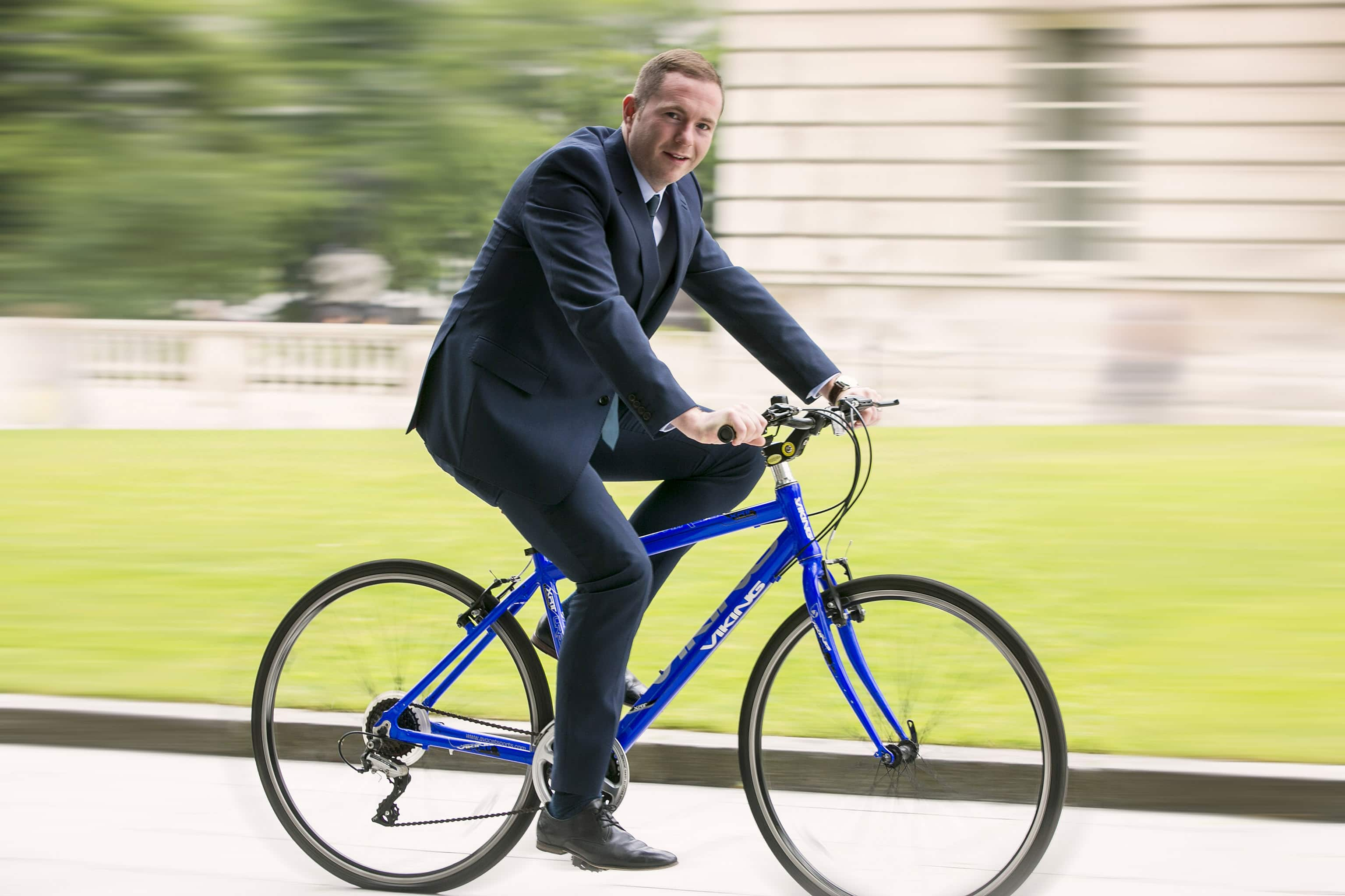 Minister Hazzard Shows Pedal Power Over Car At Bike Week
