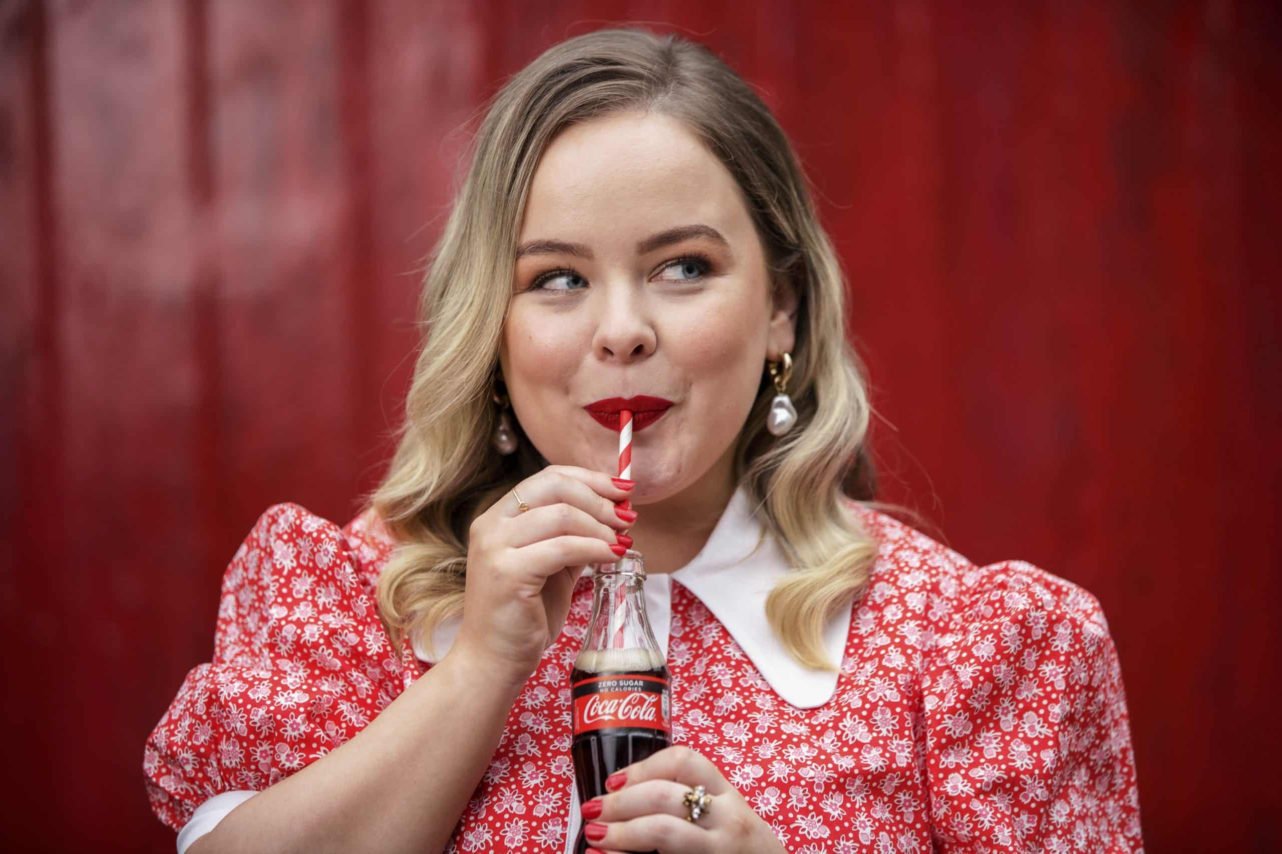 Nicola Coughlan joins Coca-Cola to invite people to enjoy a free Coke to support local bars, restaurants, and cafes across the nation
